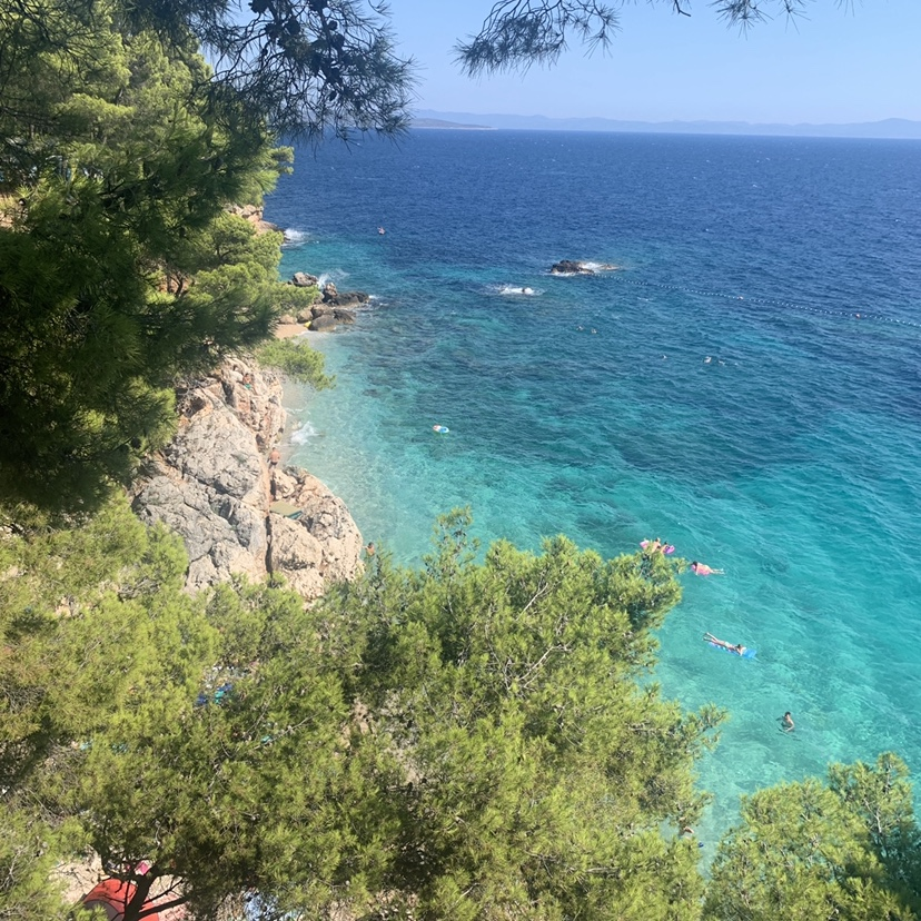 A view of cliff and urquoise water as part of the things to do in Hvar.
